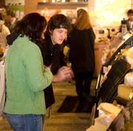 Two customers looking at some of our cheese varieties